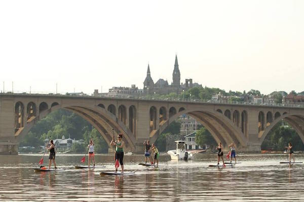 Stand-up paddle boarding after brick-nic in Georgetown